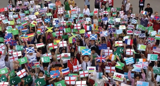Pupils holding up their flags they had made