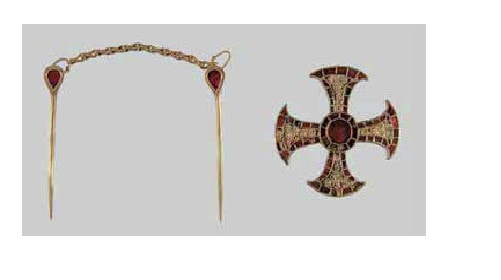 A cross and a ladies head piece