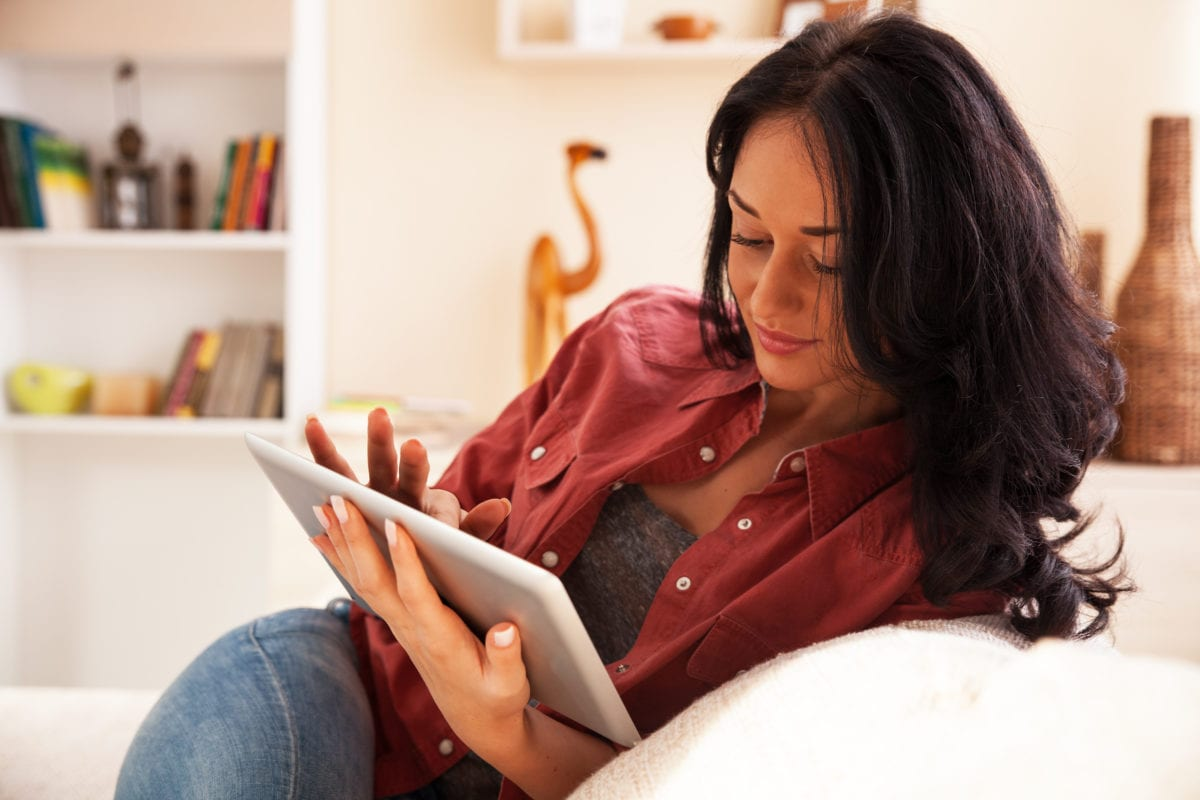 A woman browsing on an iPad